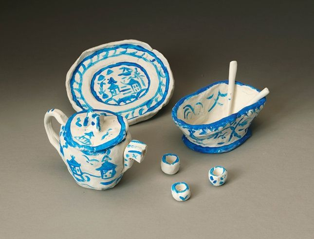 What kinds of designs have you seen on dinner plates, teapots, and vases? Porcelain is just one of many Chinese inventions.     1.   Many items we use everyday were invented in China centuries ago. Find out how porcelain has been made for more than 2000 years. You will find that it traditionally is decorated with blue and white designs of bridges, tea houses, boats, and willow trees.