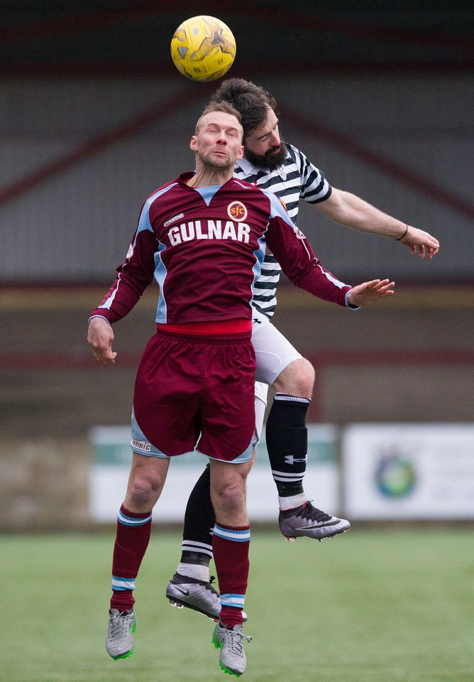 Queen's Park's Bryan Wharton wins the header during the Ladbrokes League One game between Stenhousemuir and Queen's Park.