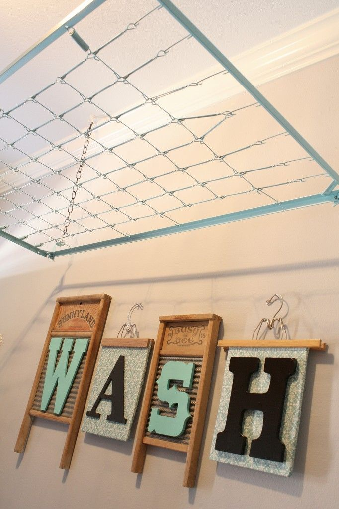 Laundry room decor...Crib Spring Drying Rack & sign I like the letters and old wash boards...