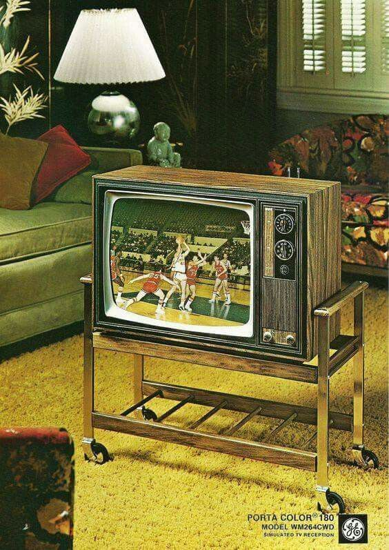 I remember at about age six, my parents making me watch the moon landing on a tv a lot like this. Ours was in black and white though.