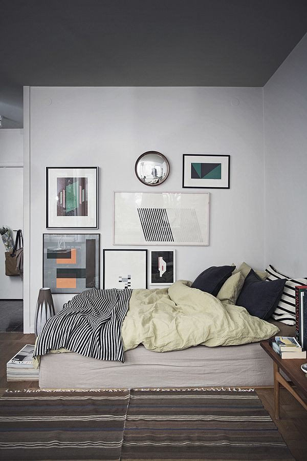 Dark grey ceiling in this bedroom looks amazing - just that one feature makes the room so interesting / cosy / unique (although everything about this room is pretty wonderful).