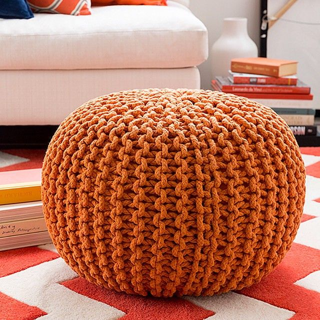 Burnt orange accessories, like this pumpkin orange pouf, are making their way into home decor.