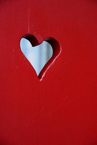 White heart on red door.