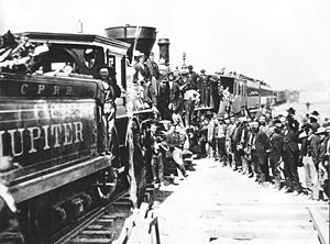 """April 28, 1869: Railway workers for the Central Pacific Railroad lay 10 miles of track in a single day. A horde of Irish and Chinese laborers accomplished the task, using 5 trainloads of materials, and setting a record that has not been beaten to this day. Photo is of the ceremonial """"Golden Spike"""" driven on May 10th of the same year, celebrating the completion of the Transcontinental Railroad."""