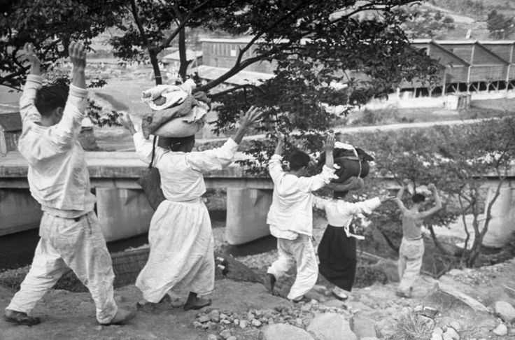 Rebels are marched with hands high by South Korean Soldiers on their way to trial, after the 1948 Yeosu-Suncheon rebellion against the Rhee government. Carl Mydans, Time/Life. Not published.
