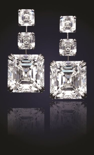 24.81 Carat Asscher-cut diamond earrings. The bottom match pair totals at 20.47 total carat weight. Both Diamonds are GIA certified. Above are one carat diamonds each which allow for the bottom diamonds to drop perfectly. All six diamonds are K color VS2 and sit 100 percent top white. An amazing pear of earrings which can not be found anywhere else.  Designed by Viggi.