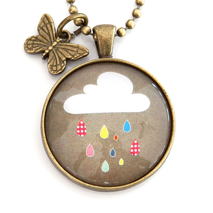 Cloud pendant with butterfly charm.