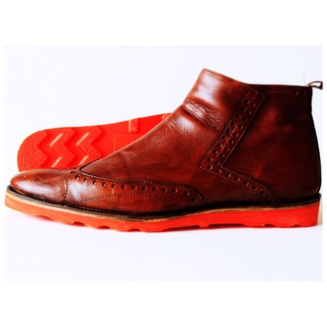Resoled Cole Haan Brogued short wing zip boot with our blaze orange bricklayer outsole. Check out www.greenwichvintage.us/shop to see all of your color resole options.