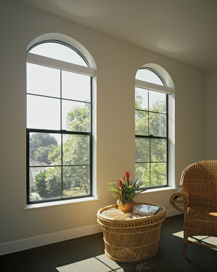 Arch window and single hung window let in