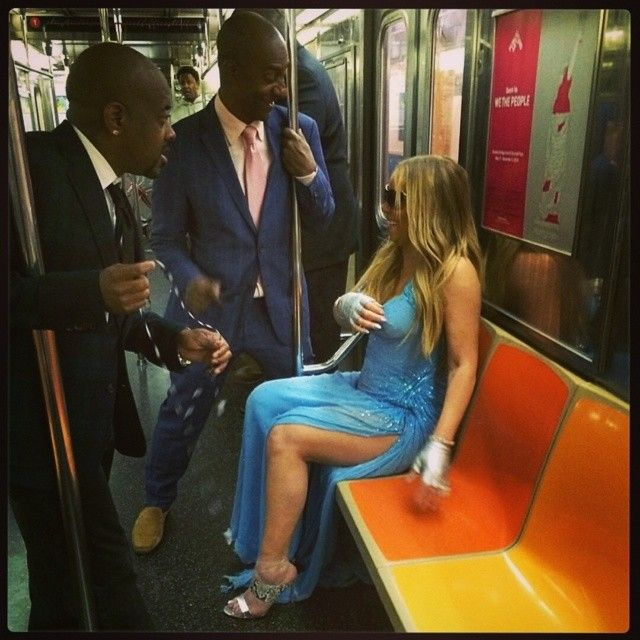 Mariah Carey's Instagram picture of her taking the New York subway dressed in an Atalier Versace blue gown and Gianvito Rossi 'Diane' mules – posted on May 30, 2014