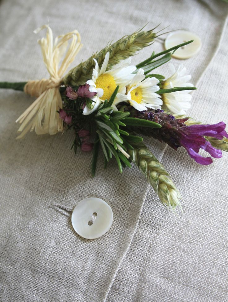 Daisies, lavender, wheat, heather, rosemary do a sweet buttonhole make. especially when finished off with raffia bows.
