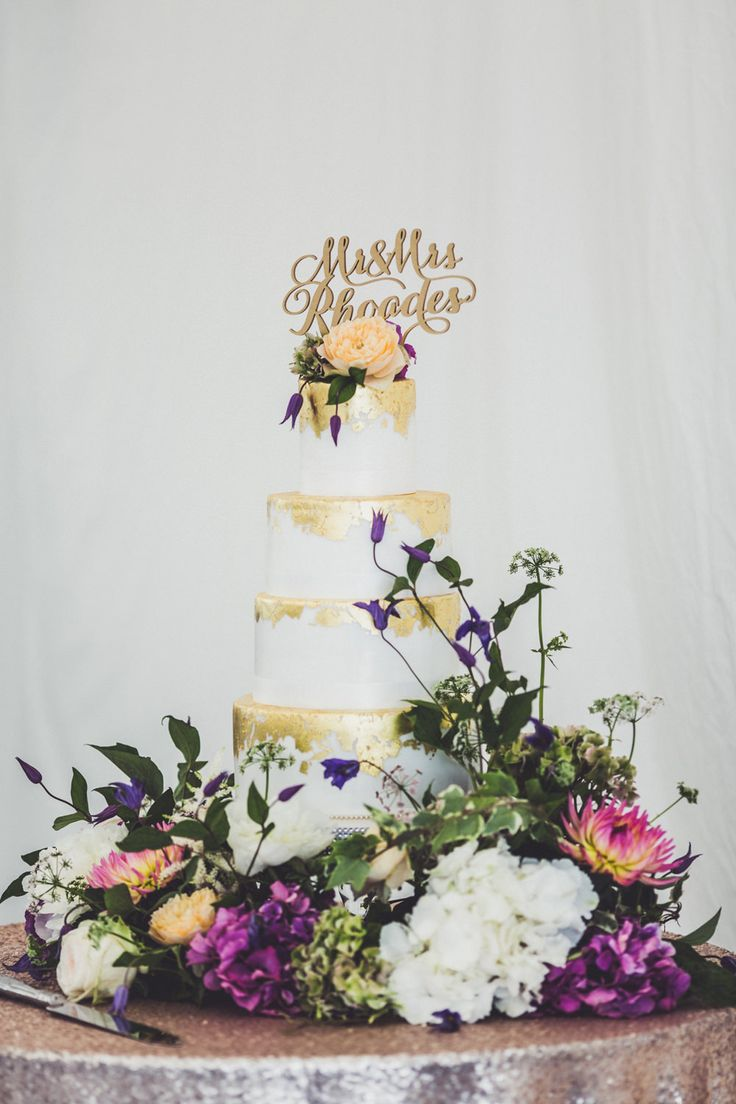 Gold Leaf Wedding Cake with Personalised Cake Topper   Memoir Suzanne Neville Wedding Dress   Marquee Reception   Claire Penn Photography   http://www.rockmywedding.co.uk/jessica-ilka/