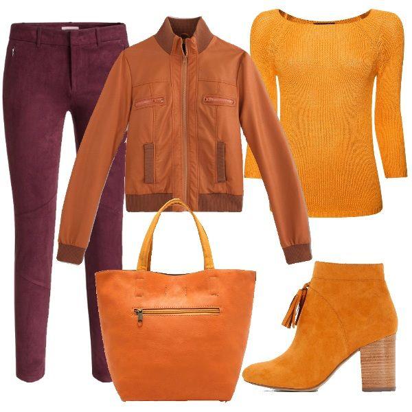 Un abbinamento davvero vivace. Pantaloni bordeaux, abbinati alla maglia con scollo a barca, al giubbino in similpelle, agli stivaletti color giallo senape, con nappina e alla borsa in tinta.