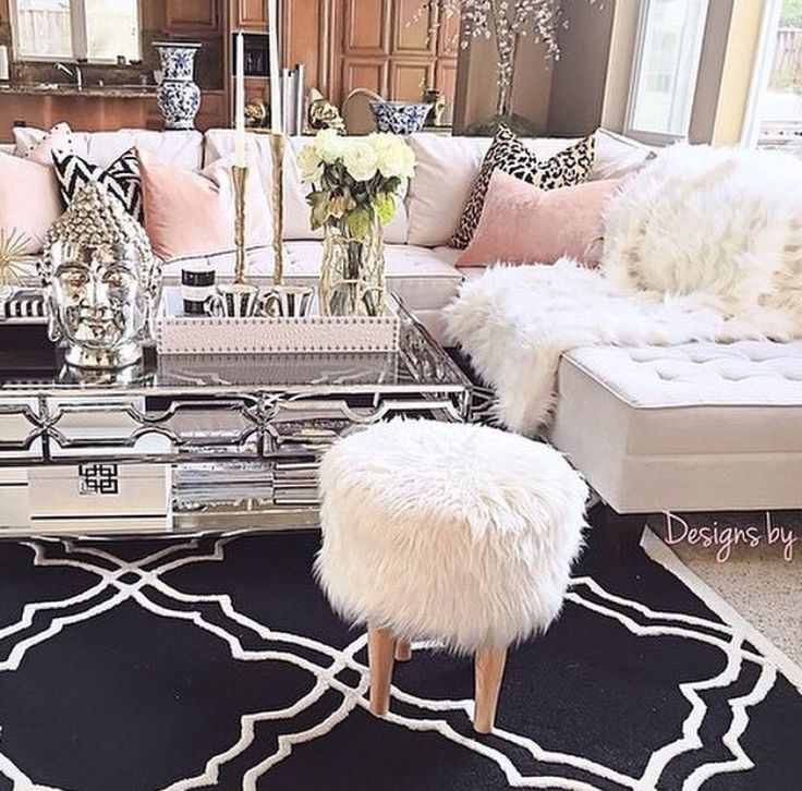 Gorgeous, feminine living room decor. Pink inspired room and white couch.