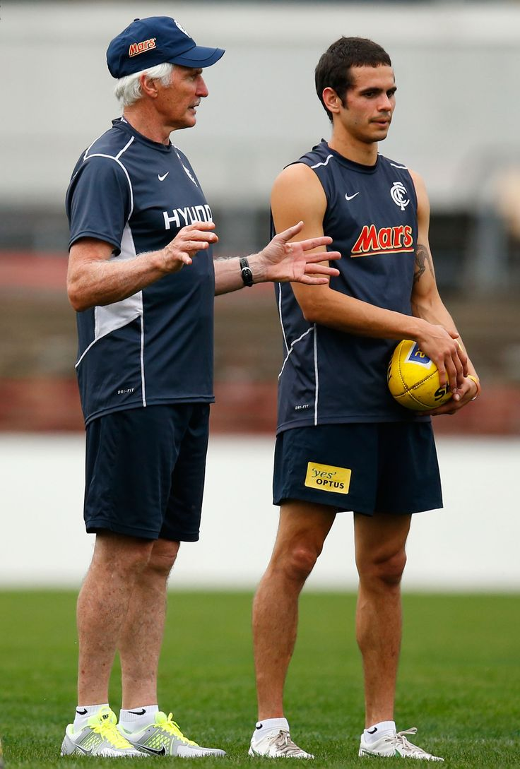Mick Malthouse and Jeff Garlett share a discussion during a training session at Visy Park in 2012. (Photo: Michael Willson/AFL Media)