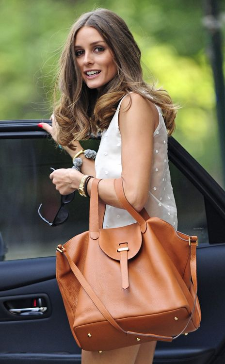 Olivia Palermo - love that big bouncey hair. Meli Melo thela bag in tan