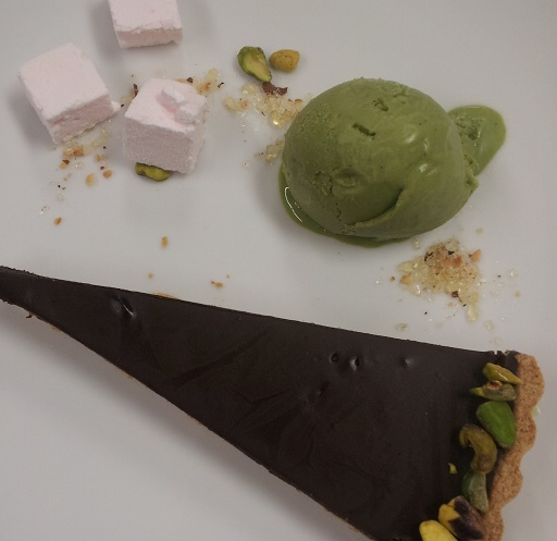 Chocolate truffle tart with house-made pistachio gelato and rose marshmallows.