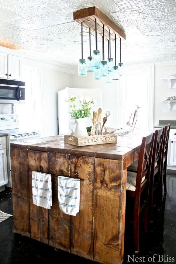 I LOVE this farmhouse kitchen island and the matching mason jar light