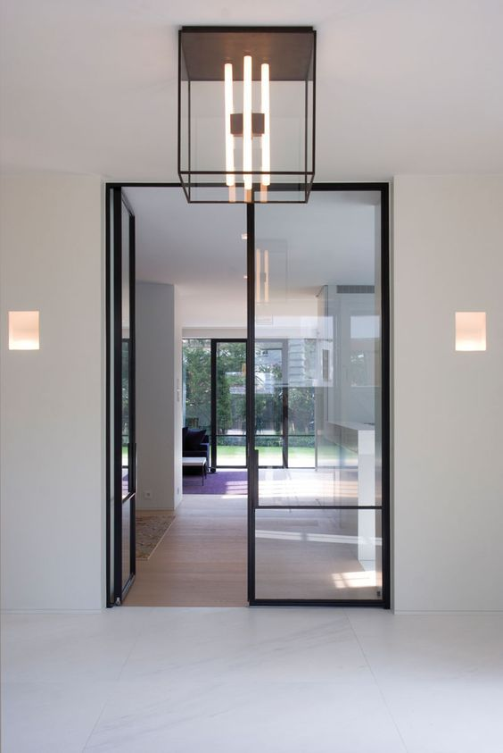Steel and glass doors - House in Knokke Belgium by Glenn Reynaert