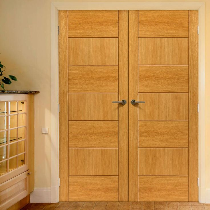 JB Kind Brisa Sirocco Flush Walnut Veneered Door Pair with directional veneers including feature grooves is Pre-finished for added style and quality. #brisadoors #doubledoors #modernoakdoorpair