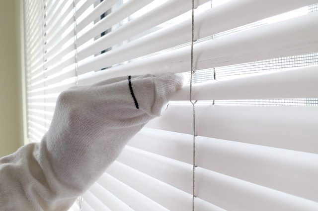 The thought of cleaning the blinds might make you fervently wish for curtains. The slats just seem to multiply as you look at them and you suddenly realize your home has too many windows -- and the kitchen blinds are probably coated with an invisible film of grease. But a couple of handy elixirs can help you make relatively short work of shining up...