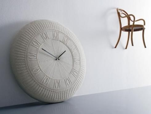 The Gomitolo Knitted Clock by Diamantini & Domeniconi. Click through to their website - they have some amazing clocks.