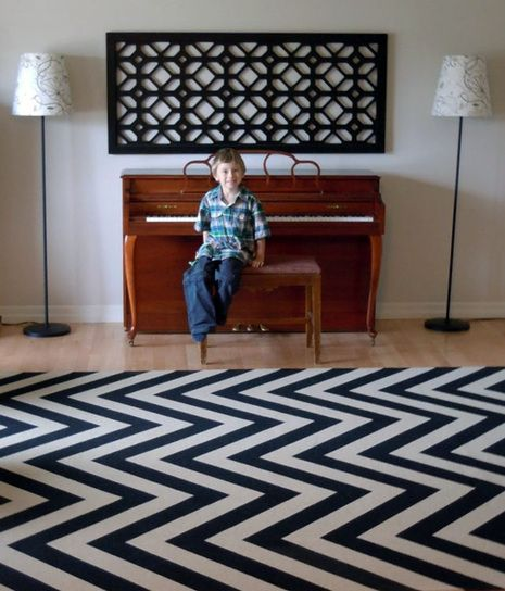 """How To Create an 8' x 10' Chevron Rug. Start with a """"low pile berber 8' x 10' area rug"""" - should be able to get a bound remnant at Home Depot for cheap."""