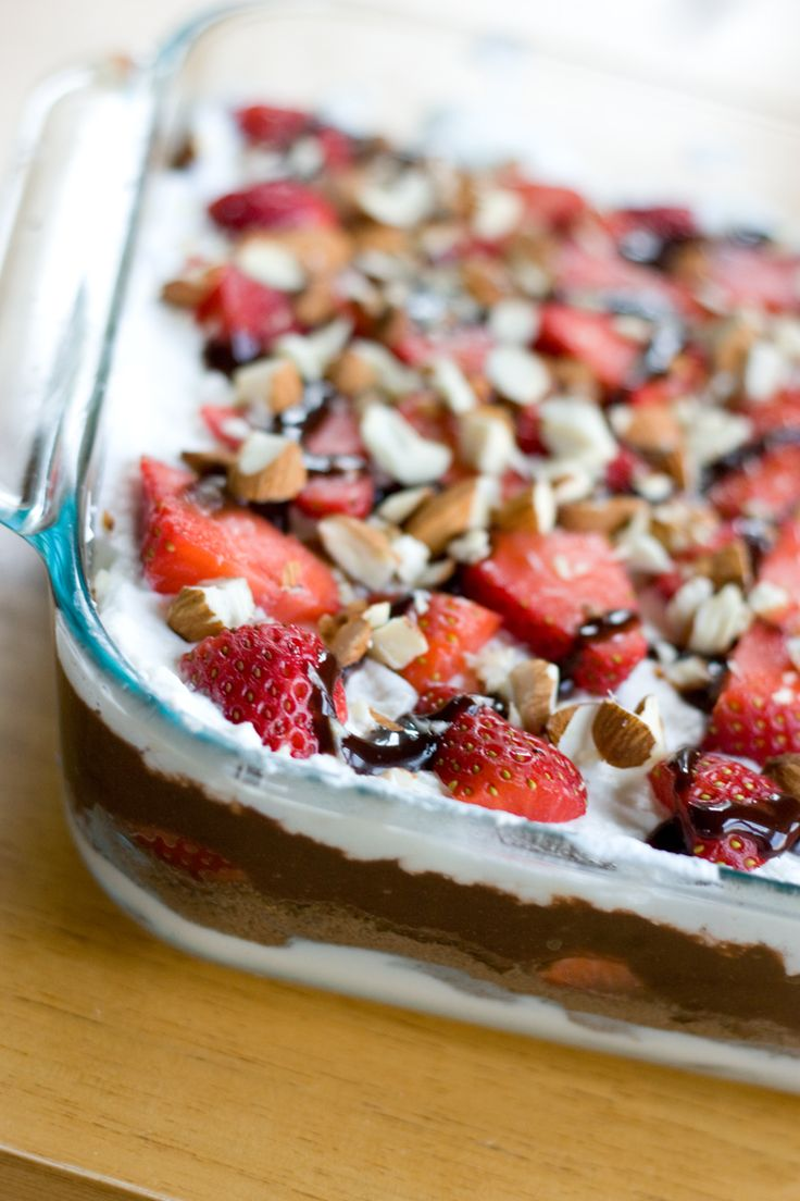 Dessert 7-Layer Dip ~ Cream cheese, crushed chocolate Teddy Grahams (or Oreos!), strawberries, chocolate pudding, whipped cream, strawberries, and chocolate sauce and almonds!!!