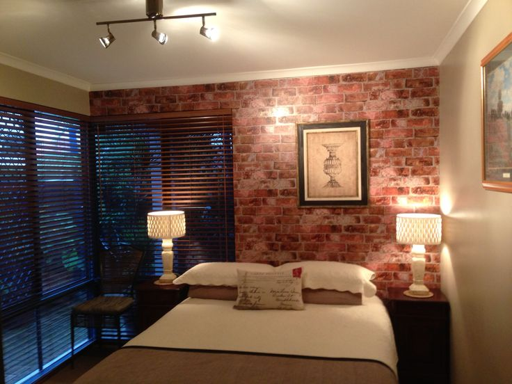 brick used as backsplash in bedroom loved the pillow. Interior Design Ideas. Home Design Ideas