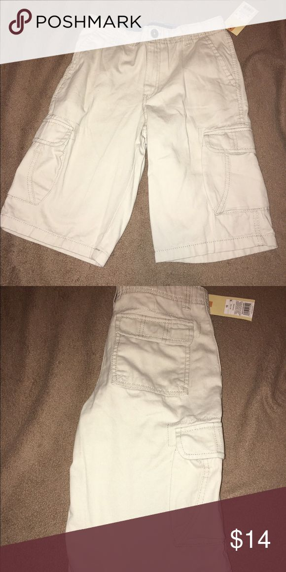 Brand new boys cargo shorts Brand new boys cargo shorts with elastic waistband. Oyster/off-white color.  size 10 Cherokee Bottoms Shorts