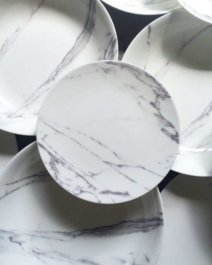 the ARK collection - Carrara Marble Dinner Plates / Salads / Large Low Bowls.