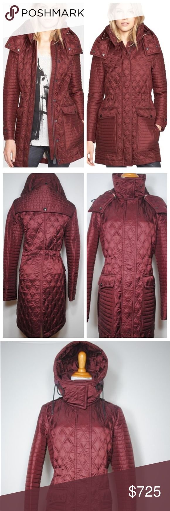 "Burberry Brit Bosdale Burgundy Coat Like new condition. A mix of channel and diamond quilting topped with a tall knit-lined stand collar for neck-warming comfort. A detachable hood adds versatile weather protection while dual-entry oversized pockets keep hands cozy and gear safely stashed. An interior drawstring at the waist keeps the look trim and shapely. 32"" length (size Medium). Hidden front zip/snap closure. Detachable hood. Snap-tab cuffs. Woven check quilted lining, with 100%…"