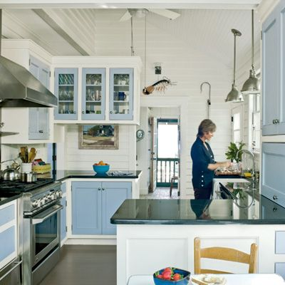 A large, galley-style kitchen is a perfect fit for a modern beach cottage.