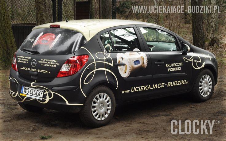 Opel Corsa Clocky - Uciekające Budziki, okleina czarny mat