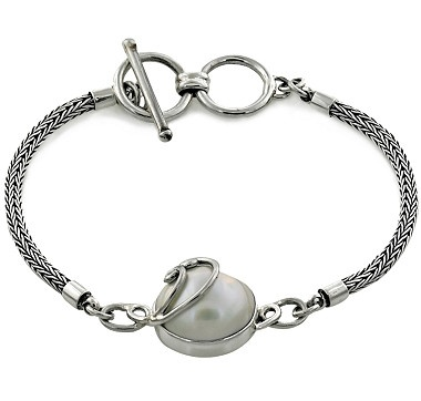 """Samuel B. Sterling Silver   White Mabe Pearl Bracelet   Sterling silver (average silver gram weight is 9.10)  • (1) 14mm round shaped white mabe pearl  • The bracelet measures approximately 7 3/4"""" in length  • Clasp: Toggle • Oxidized finish  • Nickel free"""