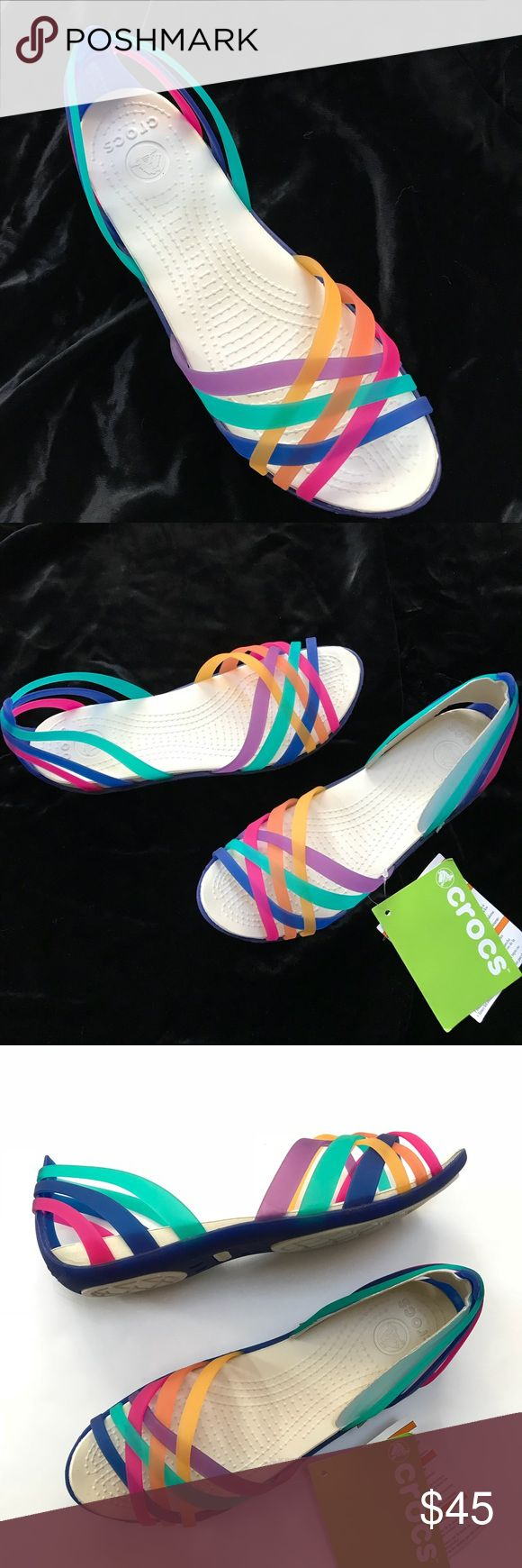 Crocs Rainbow Huarache Flat Sandals Shoes.  Size 7 Crocs Rainbow Sandals Shoes.  Women's Size: 7.  Style Huarache Flat.  Relaxed Fit.  Multi Color / Cerulean Blue.  Slip On.  Rubber / Jelly.  New with Tags- Unworn.  Store Display- May have Minor Markings.  One Shoe is Black Marked on Bottom Outsole. CROCS Shoes Sandals
