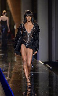 From today's New York Times, the fashion world icon returns - Naomi Campbell (43) walking the Versace couture show.
