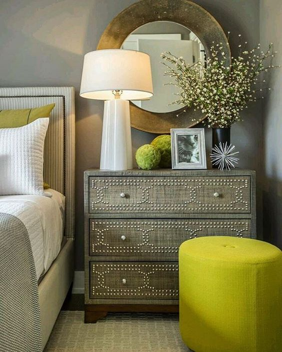 A neutral bedroom can be spruced up with greenery pillows and ottomans. #pantone #pantonecoloroftheyear #greenery