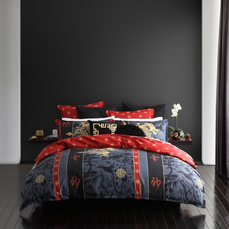 Mahjong Red captures the spirit of the Imperial East. The pictorial background in black and granite is overprinted with majestic dragons and Oriental motifs in gold, contrasted with touches of dramatic red. The secondary red and gold seal pattern features on the printed reverse and matching European pillowcases, giving this story a striking look. #loganandmason