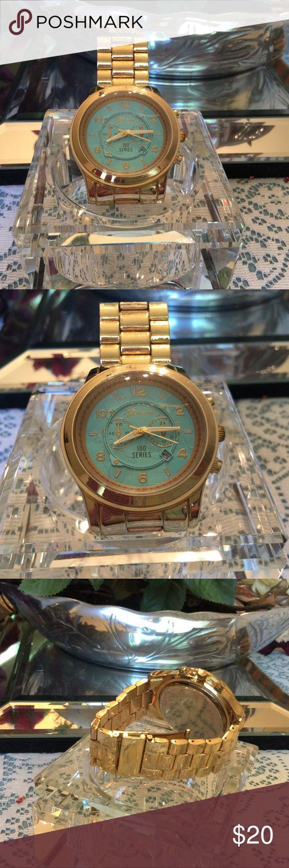 Geneva Boyfriend Watch Gold tone with robins egg blue face. It is Geneva's 100 Series Boyfriend Watch. Needs battery.🎀🎀 Geneva 100 Series Accessories Watches