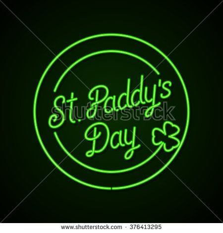 Glowing neon sign - St. Paddy's Day lettering with shamrock on a dark green background.