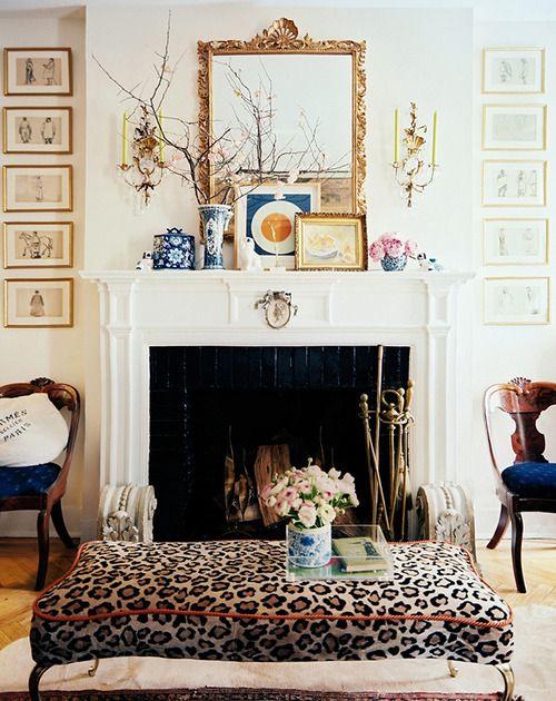 pretty mantel,animal prints,goldtone mirror frame