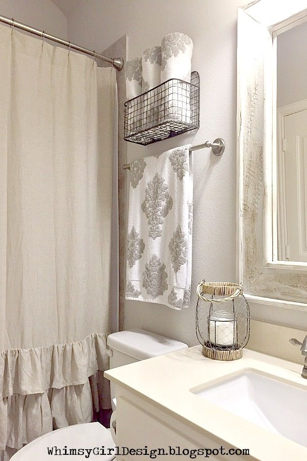 I added a touch of farmhouse flair to our guest bathroom using this metal hanging basket from HomeGoods to display pretty towels!  {Sponsored Pin}
