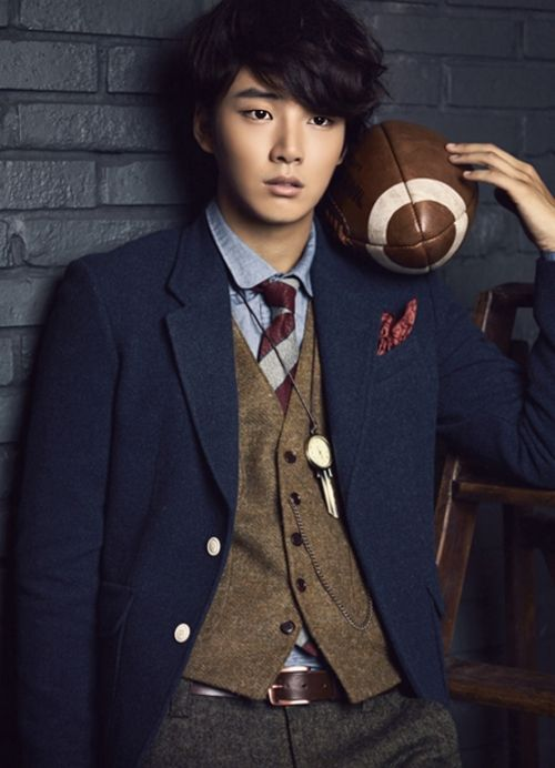 Yoon Shi Yoon with a football..... slightly freaking out!