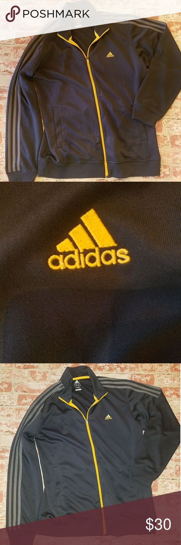 "Adidas zip up jacket Adidas clima365 zip up jacket Classic style with three stripe Dark gray almost looks blue Gray strips Yellow gold trim Excellent condition Size L 22"" across chest laying flat  28"" long adidas Jackets & Coats"