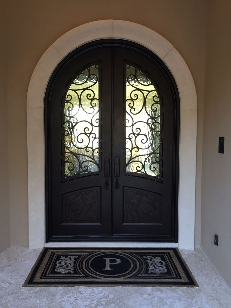 We specialize in custom wood doors and wrought iron doors.