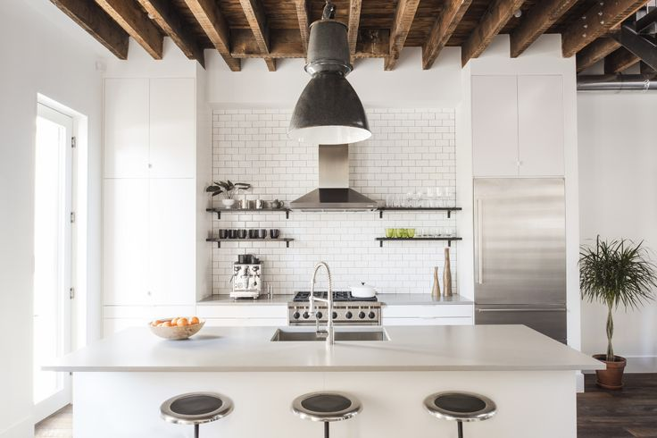White kitchen with stainless steel and black accents. Love the open ceiling concept