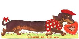 "Vintage Dachshund Valentine - This Dachshund wears a red sweater and hat - and carries a heart.  ""I long to see you.  Dog-gone it!"""