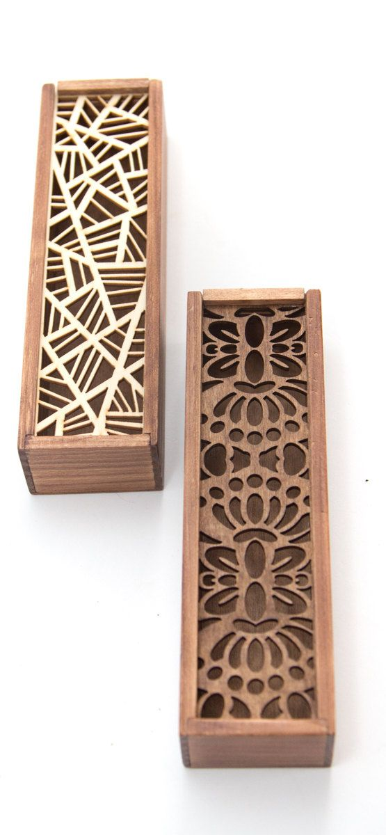 Store your pens and pencils in style with these love wooden pencil boxes. Each box features a geometric tribal design cut out of the slidable cover.