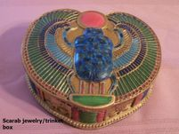 Scarab Beetle Jewelry/Trinket Box The inside is lined.  In ancient Egypt, the scarab beetle represented ascension, renewal, and rebirth.  Great to store your crystals in too!  FOR MORE DETAILS AND TO BUY VISIT:  http://www.sanctuaryofwellness.ca/egyptian-style-jewelrygifts.html --Edmonton, Alberta.